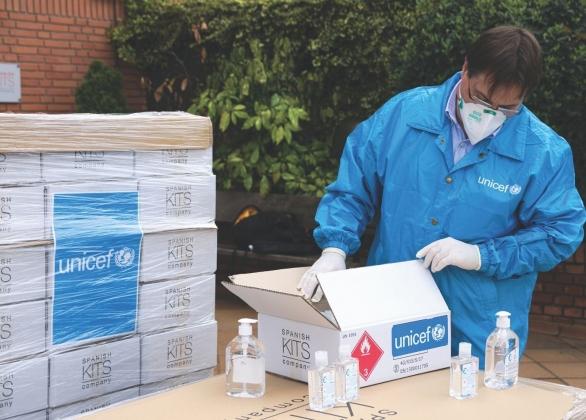 UNICEF healthcare worker packages medical supplies in Spain.