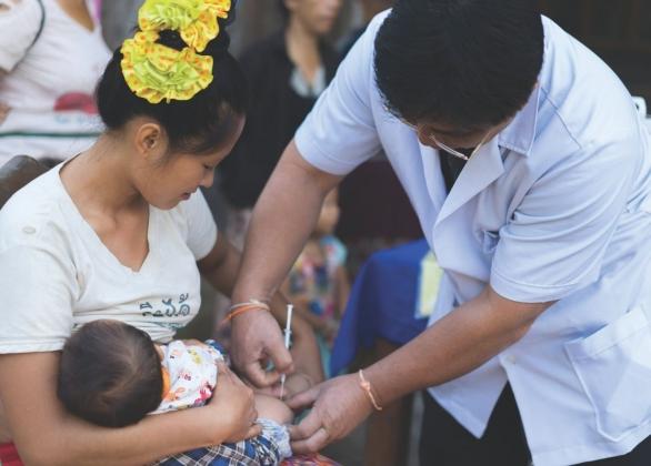 a mother receiving a tetanus shot
