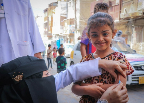 A boy recieves a vaccine to protect against a measles outbreak.