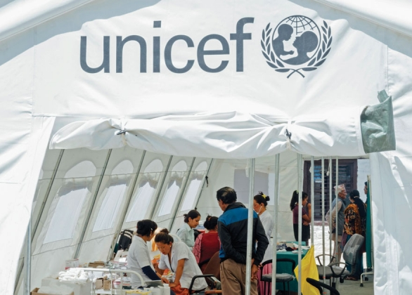 UNICEF emergency medical tent with workers