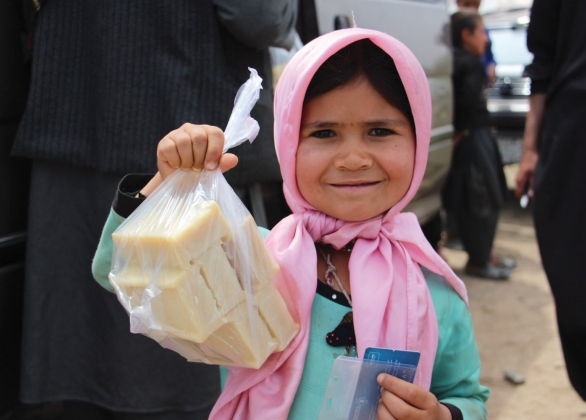 A girl in Afghanistan holds bars of soap received from UNICEF.
