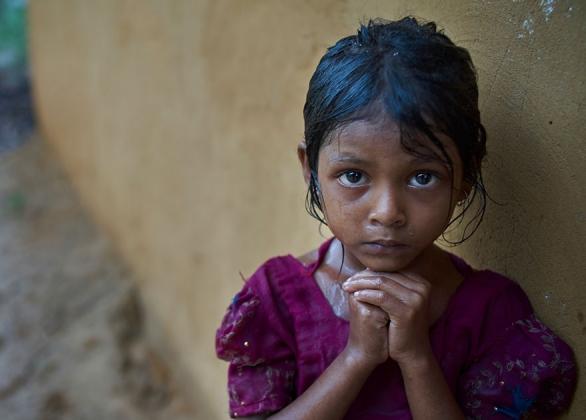 A child in the rain.
