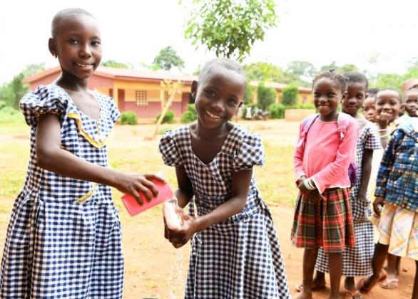 Girls washing their hands at school