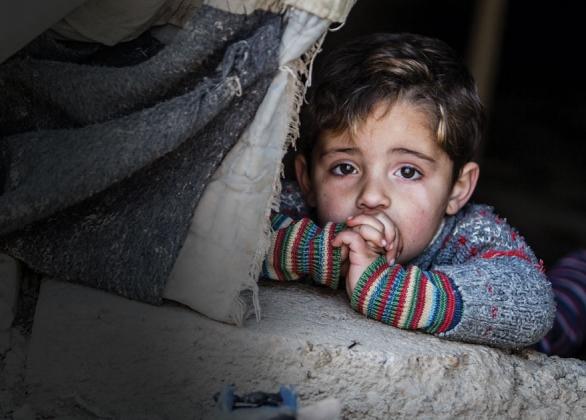 an anxious boy in a concrete home